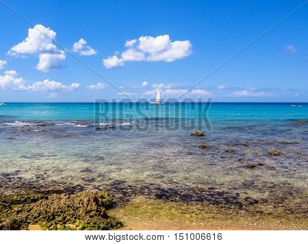 Tropical clear caribbean waters with reef for great snorkeling. The popular resort of Bayahibe, near La Romana, Dominican Republic. Summertime concept. Caribbean summer holidays.