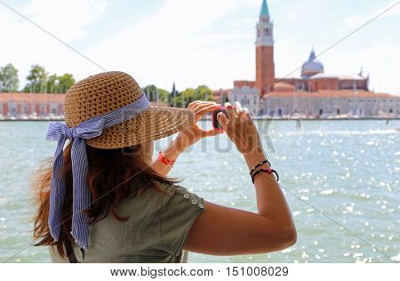 Lady With A Big Straw Hat Taking A Picture In The Basin Of San M