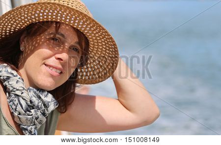 Cute Forty Year Old Woman With Straw Hat On The Cruise Ship