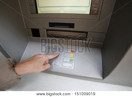 Hand Of Woman While Enter The Secret Code In The Door Of The Atm
