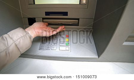 Hand Of Woman While Waiting The Money From Atm