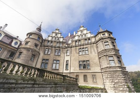 MOSZNA POLAND - OCTOBER 07 2016 : View on 17th century Moszna Castle on a sunny day.It is a historic castle and residence located in a small village one of the best known monuments in the western part of Upper Silesia.