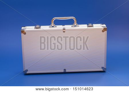 Metal silver case on a blue background
