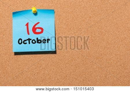 October 16th. Day 16 of month, color sticker calendar on notice board. Autumn time. Empty space for text.