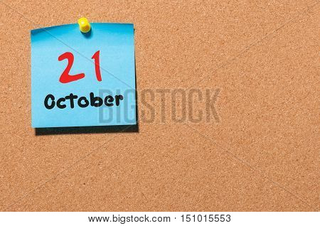 October 21st. Day 21 of month, color sticker calendar on notice board. Autumn time. Empty space for text.