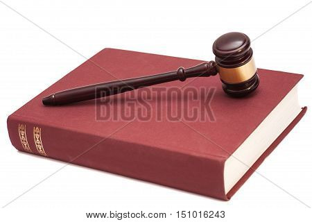 Gavel and book isolated on white background
