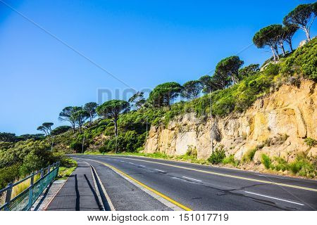 Scenic highway on the famous Cape of Good Hope in the Atlantic. The concept of active tourism and recreation. Travel to South Africa