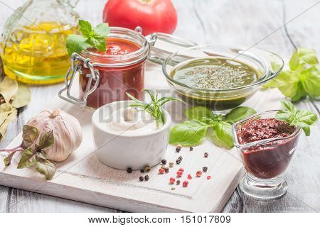 Various dip sauces on white wooden table
