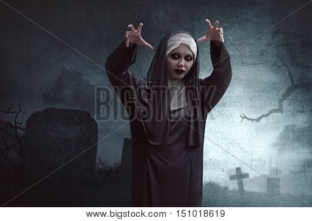Scary Asian Nun Standing In Cemetery