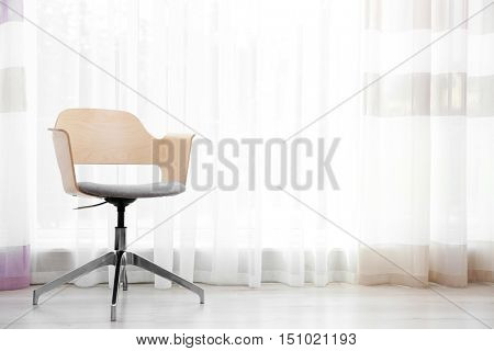 Simple interior with stool on curtains background