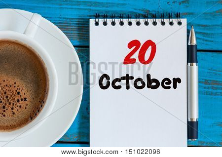 October 20th. Day 20 of month, calendar with yellow tea cup at Software Engineer workplace background. Autumn time. Empty space for text.