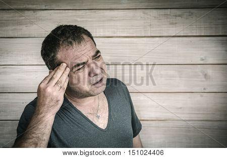 Portrait of a worried man with a headache
