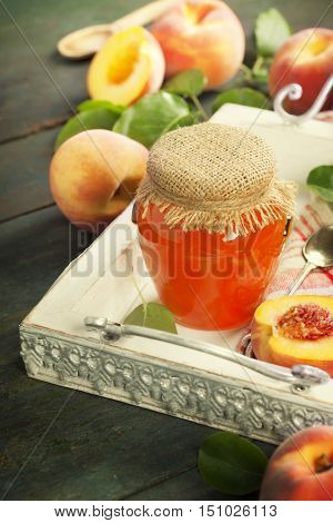 Peach jam with fresh peaches on rustic table. Homemade bio food concept