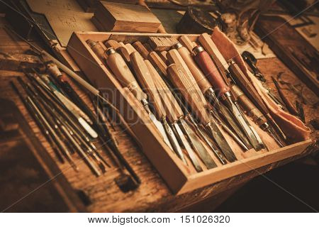 Close-up of the carpenter tools in restorer workshop.