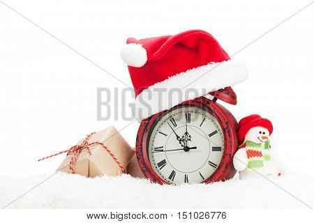 Christmas gift box, snowman toy and alarm clock in snow. Isolated on white background