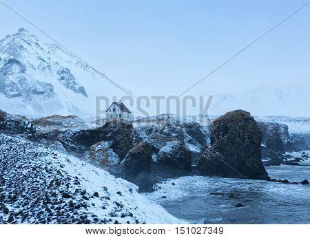 Cliffs near Arnarstapi village at dusk in winter, Snaefellsnes, Iceland.