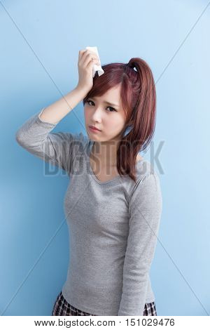 woman have a sick and painful isolated on blue background asian