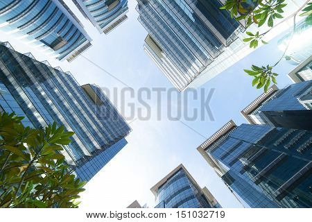 Common modern business skyscrapers high-rise buildings architecture raising to the sky sun. Concepts of financial economics future etc.
