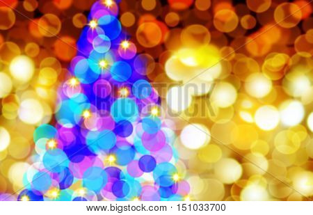Defocused Bokeh Background Effect. New Year Boke Lights Xmas Christmas Tree And Festive Illumination. Christmas tree lights at night.