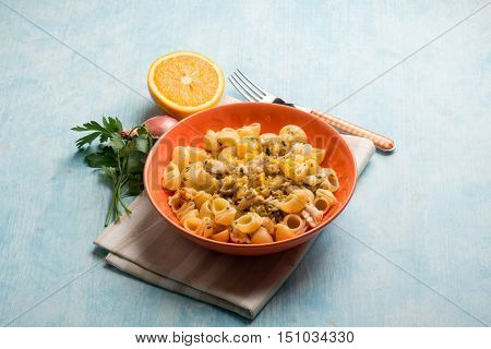 pasta with fish ragout and grated orange peel