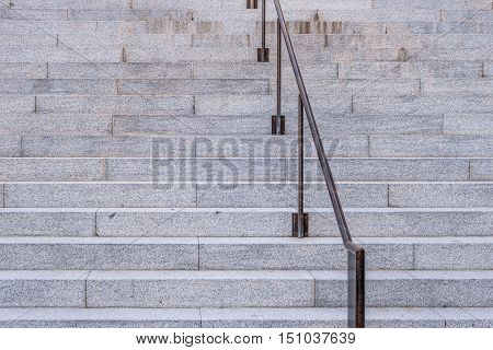 Many granite steps and handrail. Front view.
