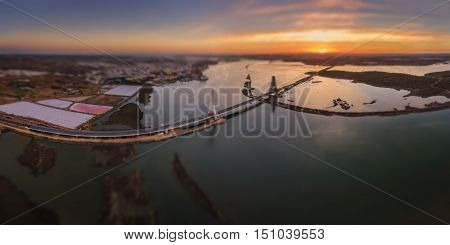 Horizontal panorama of the river Arade bridge. Sunset