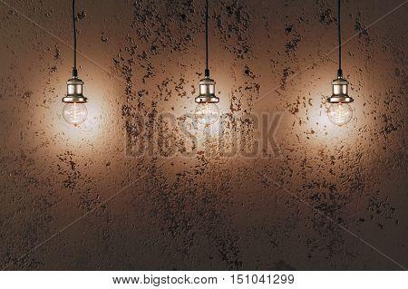 Industrial pendant lamps against rough wall. Loft interior. Edison bulbs.