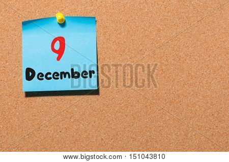 December 9th. Day 9 of month, Calendar on cork notice board. Winter time. Empty space for text.