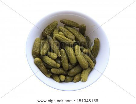 a plate of pickles isolated in a white background