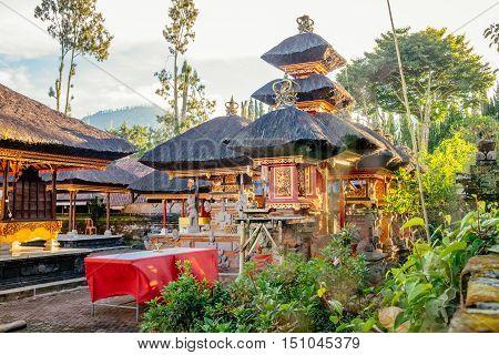 Buddhist stupa in gardens of Pura Ulun Danu pagoda temple on a lake Bratan, Bali, Indonesia. Asia landmark