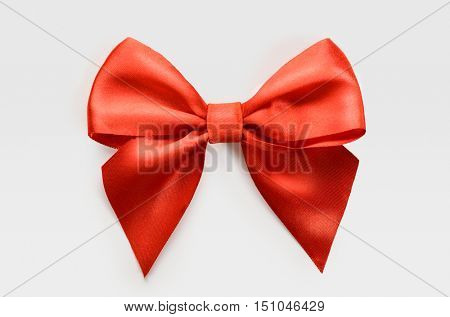 red satin bow on white background, whole object is cut with clipping path