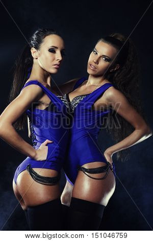 Two sexy woman posing in lingerie, Go-Go dance