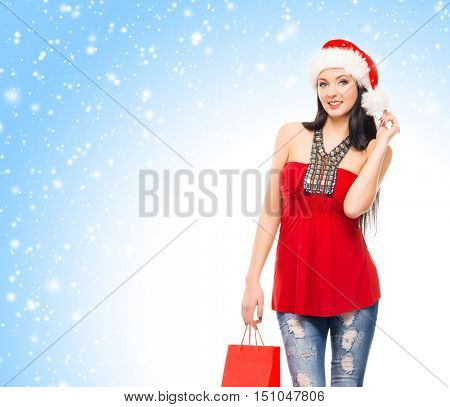 Young and beautiful Christmas shopper girl over Christmas background with snow flakes