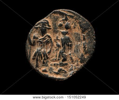 Ancient Copper Byzantine Coin Isolated On Black