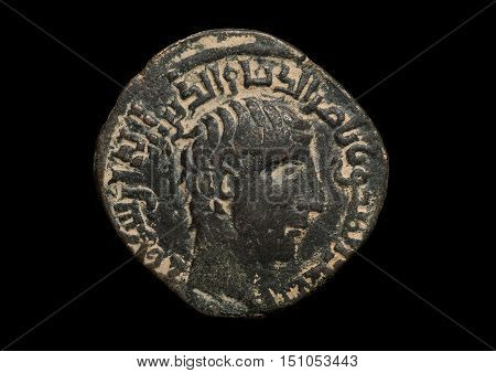 Ancient Bronze Islamic Coin With Portrait Isolated On Black