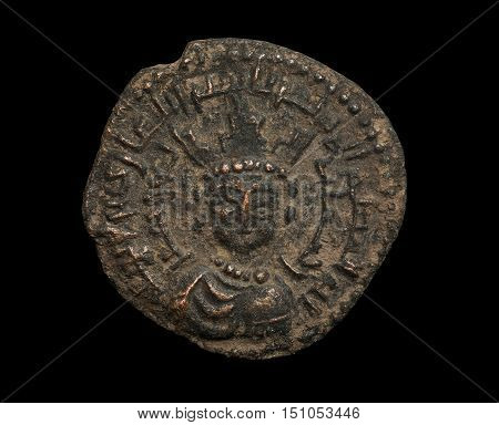 Ancient Bronze Islamic Coin With Ruler With Crown On His Head Isolated On Black