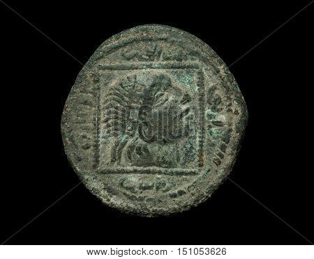 Islamic Ancient Bronze Coin Isolated On Black