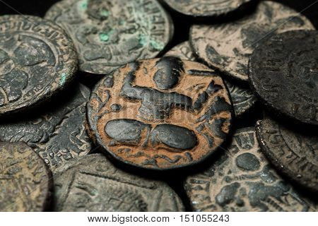 Ancient Islamic Copper Coin In Pile Of Other Coins