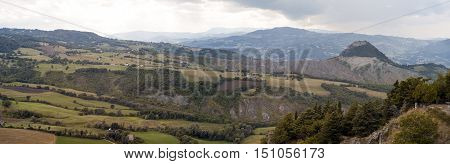 Wide angle view of the hills around the medieval village of San Leo, close the border between Emilia Romagna, Marche and Tuscany. Color image.