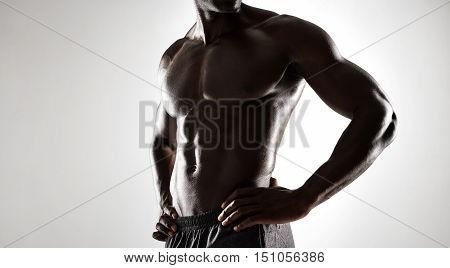 African Man With Muscular Body On Grey Background