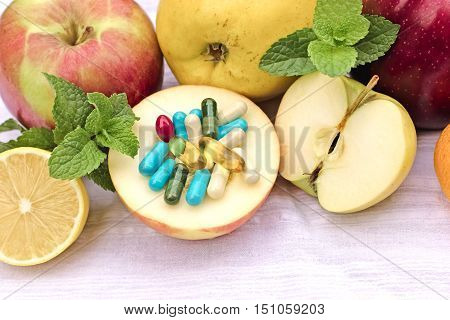 Fresh organic fruit and supplements nutrition make up complete diet