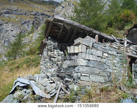a ruined stone house in mountain terrain