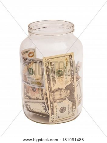 US dollar banknotes in jar on white background