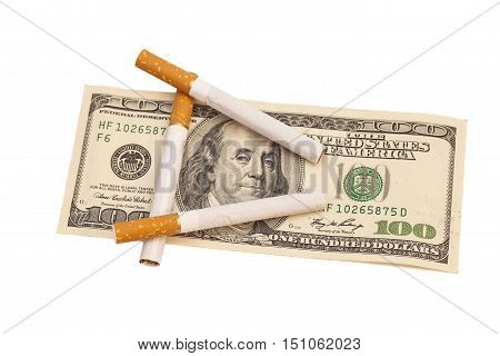 Cigarettes on one hundred dollar bill on white background
