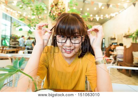 Asian Hipster Nerd Glasses Women Sitting At The Coffee Shop