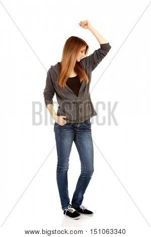 Teenage woman sniffing her armpit