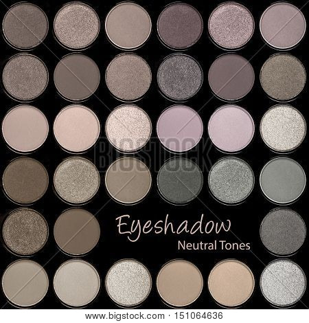 A background palette of eyeshadows in smokey neutral tones