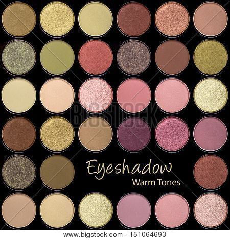 A background palette of eyeshadows in warm autumn tones of green, pink, gold and brown.