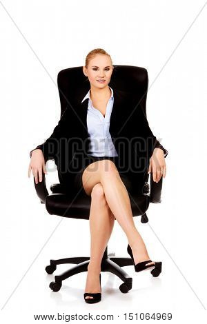 Young smile business woman sitting on a chair in office