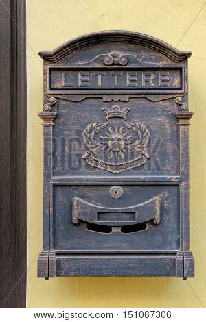 Antique metal mail box on the yellow wall